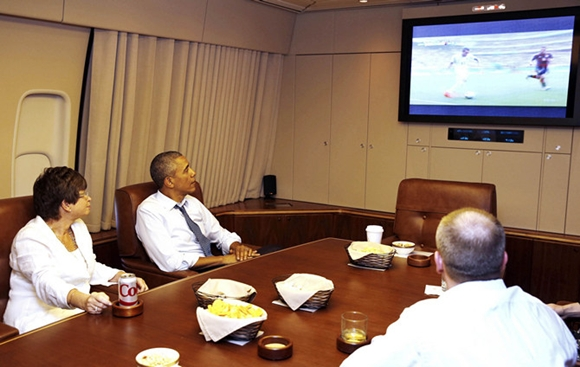 U.S. President Obama and his senior advisor Jarrett watch the U.S. and Germany World Cup soccer match while aboard Air Force One