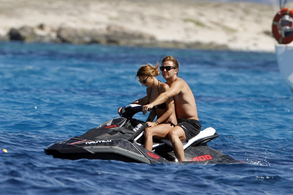 German player and World Cup hero, Mario Gotze, enjoys water biking and a mud bath with his girlfriend Ann-Kathrin Brommel