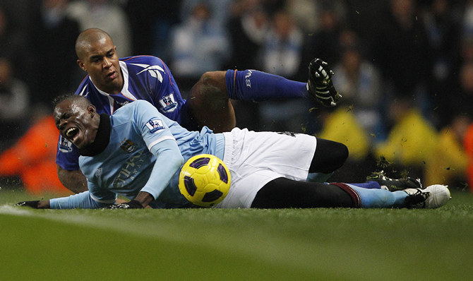 Bolton Wanderers' Knight fouls Manchester City's Balotelli during their English Premier League soccer match in Manchester
