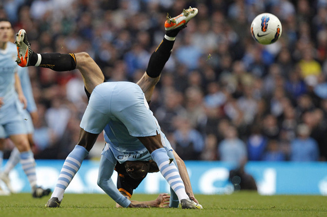Manchester City's Balotelli challenges Wolverhampton Wanderers' Johnson during their English Premier League soccer match in Manchester