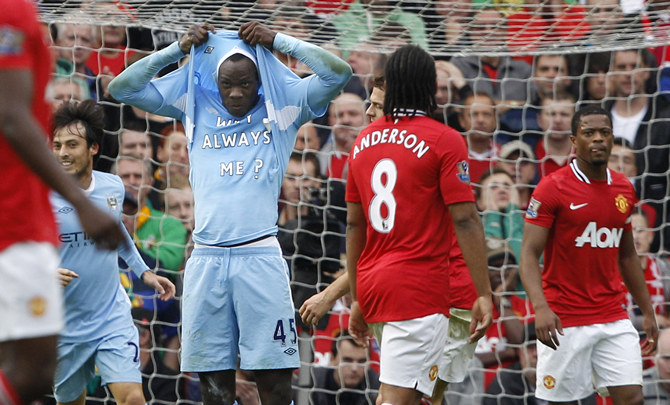 Manchester City's Mario Balotelli celebrates after scoring the opening goal against Manchester United during their English Premier League soccer match at Old Trafford in Manchester,