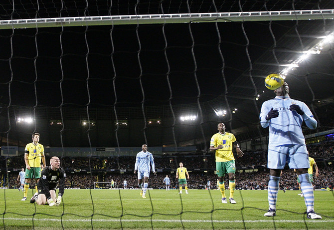 Manchester City's Balotelli scores past Norwich City's Ruddy during their English Premier League soccer match in Manchester