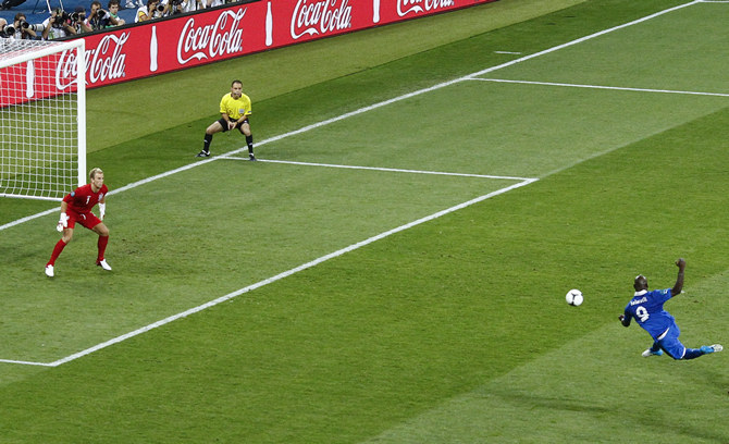 Italy's Balotelli tries to score against England's Hart during their Euro 2012 quarter-final soccer match at the Olympic stadium in Kiev