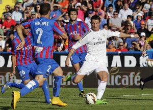 Real Madrid's Cristiano Ronaldo shoots to score against Levante during their Spanish first division soccer match in Valencia