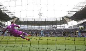 Manchester City's Sergio Aguero scores his third goal from the penalty spot during their English Premier League soccer match against Tottenham Hotspur at the Etihad Stadium in Manchester