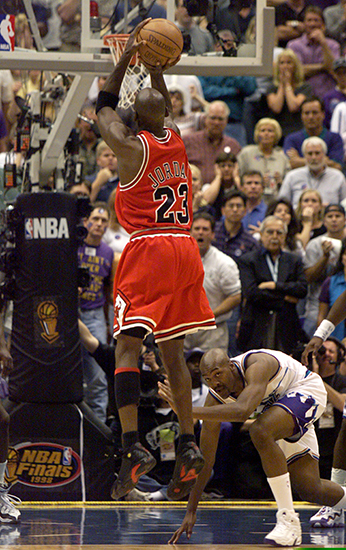 MICHAEL JORDAN SCORES CHAMPIONSHIP WINNING BASKET IN GAME AGAINST UTAH JAZZ IN SALT LAKE CITY.