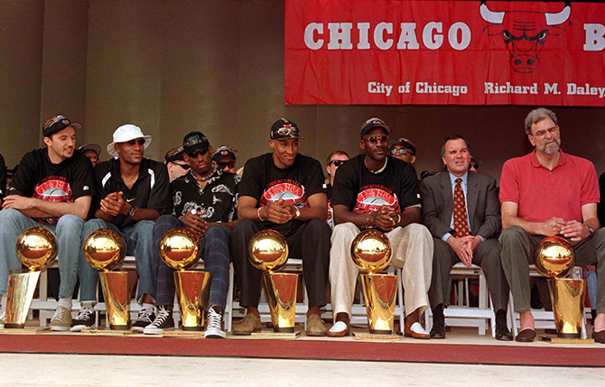THE BULLS PRESENT THEIR CHAMPIONSHIP TROPHYS IN CHICAGO.