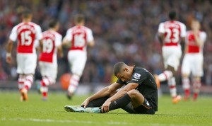 Hull's Jake Livermore reacts after Arsenal scored during their English Premier League soccer match at the Emirates stadium in London