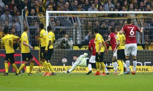 Borussia Dortmund's Weidenfeller (C) fails to save goal by Hanover 96's Kiyotake during Bundesliga soccer match in Dortmund