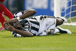 Juventus' Pogba reacts as he lies on the field during their Italian Serie A soccer match against Sassuolo in Reggio Emilia