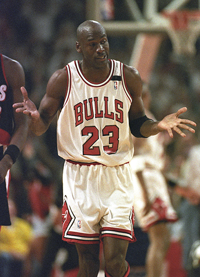 Chicago Bulls Michael Jordan shrugs after sinking a basket to set a new points record for scoring in one half of an NBA finals game during first half play against Portland in Chicago