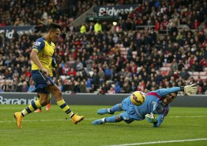 Arsenal's Alexis Sanchez shoots to score past Sunderland goalkeeper during their English Premier League soccer match at the Stadium of Light in Sunderland