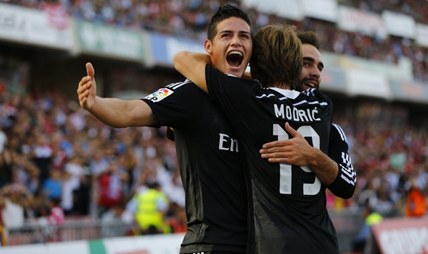 Real Madrid's Rodriguez is congratulated by teammates after scoring against Granada during their soccer match in Granada