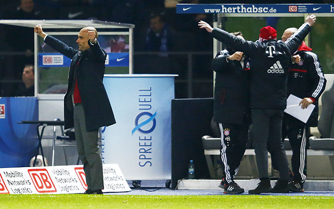 Bayern Munich's coach Guardiola sport director Sammer celebrate winning Bundesliga title after Bundesliga soccer match against Hertha Berlin in Berlin