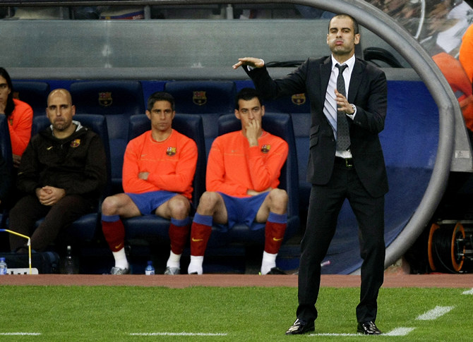 Barcelona's coach Guardiola gestures to his players during their Spanish First Division soccer match against Villarreal at Nou Camp stadium in Barcelona