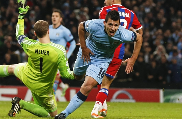 Manchester City's Aguero celebrates after he scored the winning goal against Bayern Munich's Neuer during their Champions League Group E soccer match in Manchester