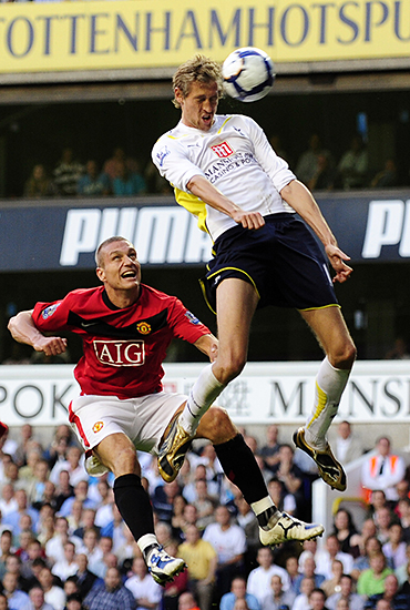 Tottenham Hotspur's Peter Crouch heads for goal past Manchester United's Nemanja Vidic during their English Premier League soccer match in London