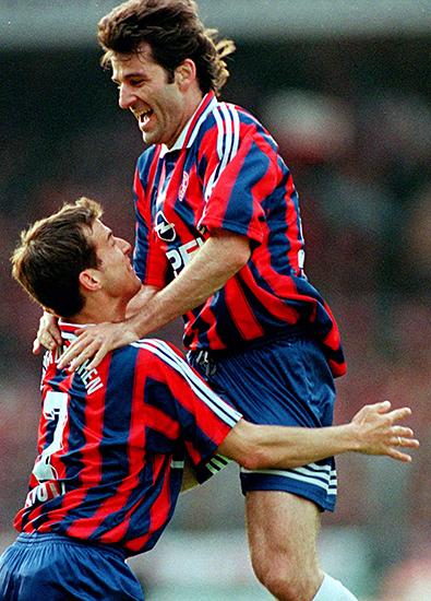 FC Bayern Munich's Emil Kostadinov jumps to his team mate Mehmet Scholl after scoring 0-1 against SV..