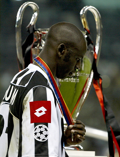 JUVENTUS' THURAM WALKS PAST THE CHAMPIONS LEAGUE TROPHY AFTER LOSING INTHE FINAL TO AC MILAN AT OLD TRAFFORD.