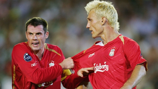 SEVILLE, SPAIN -  SEPTEMBER 13: Liverpool captain Jamie Carragher barks orders to team-mate Sami Hyypia during a second half onslaught by Real Betis during the UEFA Champions League Group G match between Real Betis and Liverpool at the Estadio Ruiz de Lopera on September 13, 2005  in Seville, Spain. (Photo by Mike Hewitt/Getty Images)