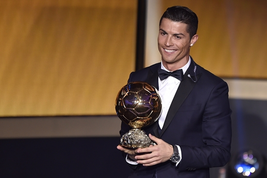 Real Madrid and Portugal forward Cristiano Ronaldo smiles after receiving the  2014 FIFA Ballon d'Or award for player of the year during the FIFA Ballon d'Or award ceremony at the Kongresshaus in Zurich on January 12, 2015.  AFP PHOTO / FABRICE COFFRINI        (Photo credit should read FABRICE COFFRINI/AFP/Getty Images)