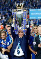 "Britain Soccer Football - Leicester City v Everton - Barclays Premier League - King Power Stadium - 7/5/16 Leicester City manager Claudio Ranieri lifts the trophy as they celebrate winning the Barclays Premier League Action Images via Reuters / John Clifton Livepic EDITORIAL USE ONLY. No use with unauthorized audio, video, data, fixture lists, club/league logos or ""live"" services. Online in-match use limited to 45 images, no video emulation. No use in betting, games or single club/league/player publications. Please contact your account representative for further details."