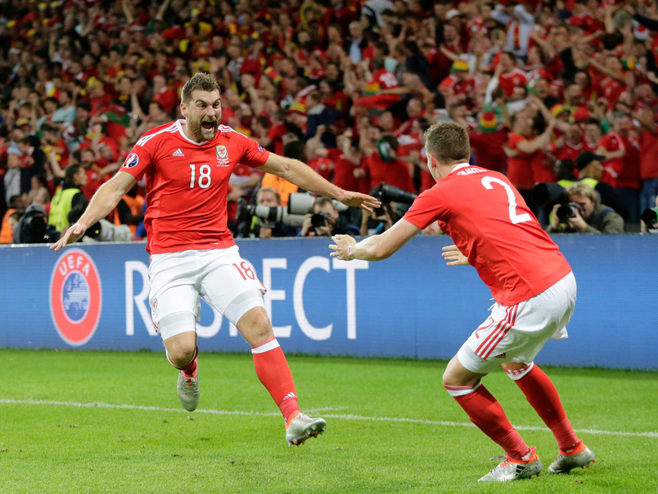 Wales' Sam Vokes, left, celebrates with his teammate Wales' Chris Gunter, after scoring his side's third goal during the Euro 2016 quarterfinal soccer match between Wales and Belgium, at the Pierre Mauroy stadium in Villeneuve d¿Ascq, near Lille, France, Friday, July 1, 2016. (AP Photo/Petr David Josek)