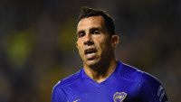"Argentinas Boca Juniors Carlos Tevez celebrates after scoring against Bolivia's Bolivar during their Copa Libertadores group 3 football match at the ""Bombonera"" stadium in Buenos Aires, Argentina, on April 7, 2016. / AFP / EITAN ABRAMOVICH        (Photo credit should read EITAN ABRAMOVICH/AFP/Getty Images)"