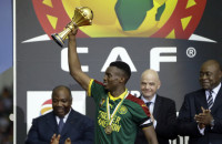 Cameroon's Benjamin Moukandjo lifts the trophy after winning the African Cup of Nations final soccer match between Egypt and Cameroon at the Stade de l'Amitie, in Libreville, Gabon, Sunday, Feb. 5, 2017. Cameroon won 2-1. (AP Photo/Sunday Alamba)